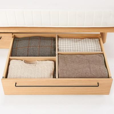 ベッドフレームの下の収納も同じ素材を揃えることで統一感のあるデザインに